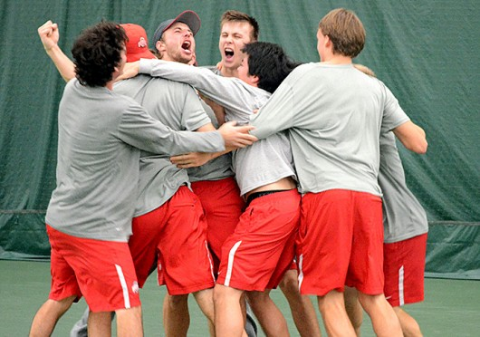 The Ohio State men's tennis team celebrates winning the ITA National Men's Team Indoor Championship against USC Feb. 17 at the Met and the Galleria Tennis and Athletic Club. OSU won, 4-1. Courtesy of OSU athletics