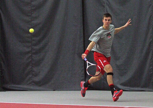 Senior Peter Kobelt returns the ball during a match against Texas A&M Feb. 9 at the Varsity Tennis Center. OSU won, 4-3. Credit: Alice Bacani / News director at BuckeyeTV