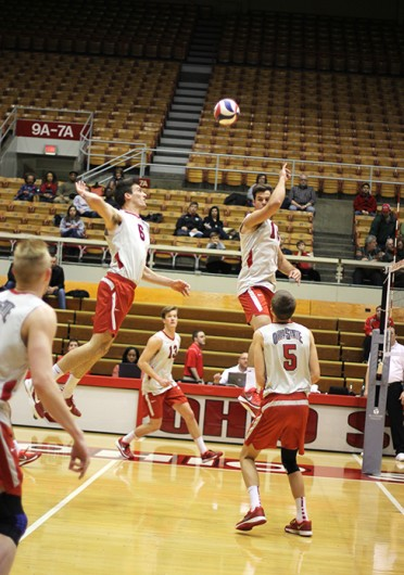Junior outside hitter Michael Henchy (6) hits the ball while junior middle blocker Dustan Neary watches during a match against Saint Francis Feb. 9 at St. John Arena. OSU won, 3-0. Credit: Shelby Lum / Photo editor