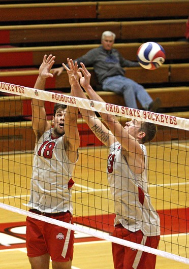 Junior middle blocker Dustan Neary (18) and freshman outside hitter Miles Johnson (13) attempt to block the ball during a match against Grand Canyon Feb. 21 at St. John Arena. OSU won, 3-0. Credit: Jonathan McAllister / Lantern photographer
