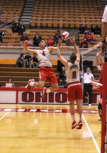 Redshirt-junior setter Peter Heinen (8) sets the ball to redshirt-freshman middle blocker Driss Guessous (4) during a match against Ball State Feb. 26 at St. John Arena. OSU lost, 3-1. Credit: Kathleen Martini / Oller reporter