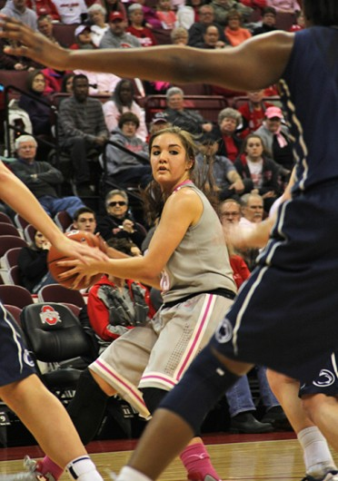 Sophomore guard Cait Craft (13) looks for an open teammate during a game against Penn State Feb. 9 at the Schottenstein Center. OSU lost, 74-54. Credit: Ritika Shah / Asst. photo editor