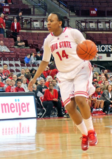Sophomore guard Ameryst Alston (14) shoots the ball during a game against Nebraska Feb. 20 at the Schottenstein Center. OSU lost, 67-59. Credit: Daniel Bendtsen / Lantern photographer