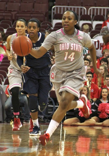 Sophomore guard Ameryst Alston (14) dribbles down the court during a game against Penn State Feb. 9 at the Schottenstein Center. OSU lost, 74-54. Credit: Ritika Shah / Asst. photo editor