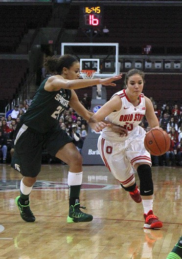 Sophomore guard Cait Craft (13) attempts to beat a defender during a game against Michigan State Jan. 26 at the Schottenstein Center. OSU lost, 82-68. Credit Kaily Cunningham / Multimedia editor