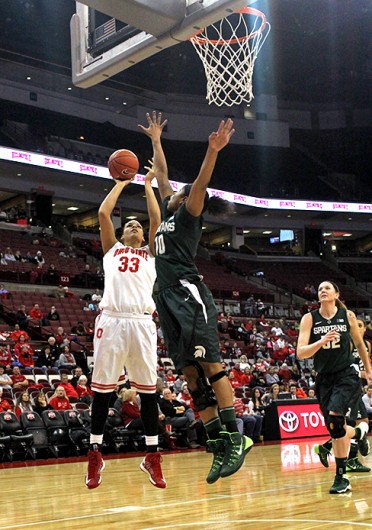 Senior center Ashley Adams (33) takes a shot during a game against Michigan State Jan. 26 at the Schottenstein Center. OSU lost, 82-68. Credit: Kaily Cunningham / Multimedia editor