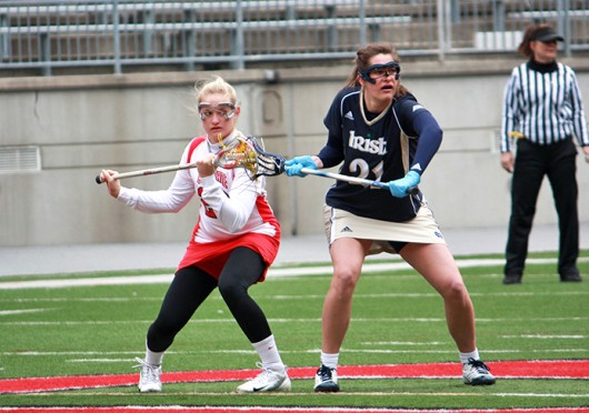 Then-sophomore midfielder Kaila Gottlick (28) fights for position during a game against Notre Dame March 4, 2012, at Ohio Stadium. OSU lost, 16-7. Lantern file photo