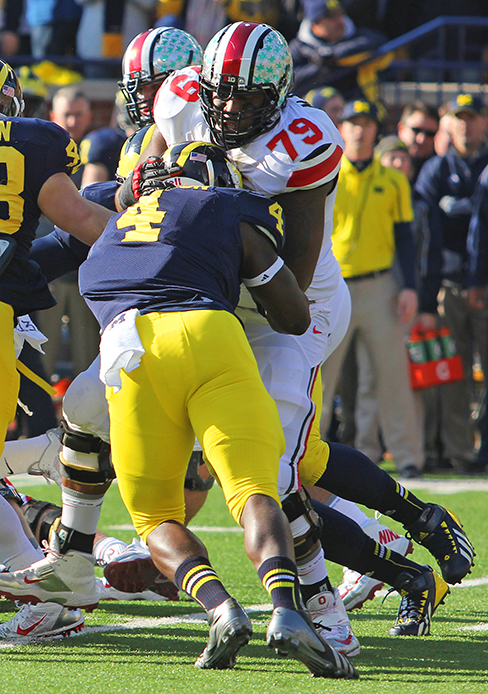 Redshirt-senior right guard Marcus Hall (79) blocks a Michigan player. OSU beat Michigan, 42-41, Nov. 29. Hall was ejected from the game after a fight.