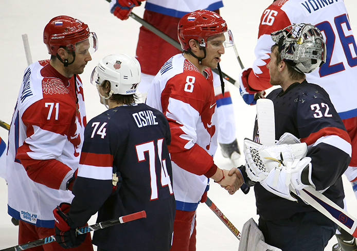 Members of the Russia and USA Olympic hockey teams shake hands after a game at Bolshoy Ice Dome during the Winter Olympics in Sochi, Russia, Feb. 15.  USA won, 3-2.