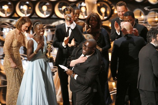 Steve McQueen pumps his fist and trophy into the air as '12 Years a Slave' celebrates on-stage during the 86th annual Academy Awards on March 2 in Los Angeles. Credit: Courtesy of MCT
