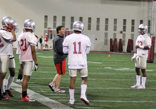 Co-defensive coordinator and safeties coach Chris Ash (left) talks to his players during spring practice March 4 at the Woody Hayes Athletic Center. Credit: Shelby Lum / Photo editor