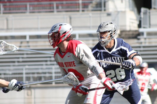 Junior midfielder Jesse King (19) looks to move the ball upfield during a game against Penn State at Ohio Stadium March 1. OSU lost, 11-7. Credit: Ryan Robey / For The Lantern