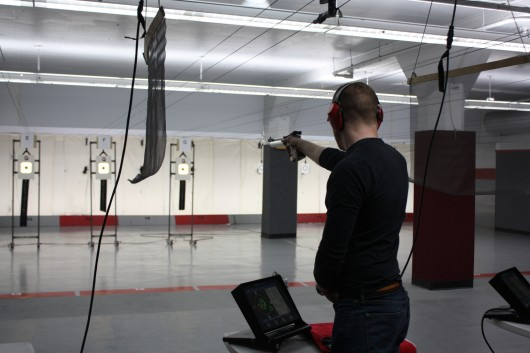 A member of the OSU pistol team lines up for a shot during practice Feb. 12 in Converse Hall at the Lt. Hugh W. Wylie Range. Credit: Nick Deibel / Lantern reporter