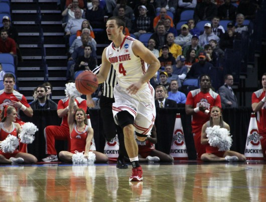 Senior guard Aaron Craft (4) caries the ball down the court in a game against Dayton. OSU lost, 60-59, at First Niagara Center March 20.