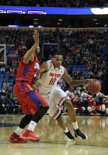 Junior forward LaQuinton Ross (10) drives to the hoop during the second round of the NCAA Tournament against Dayton at First Niagara Center. OSU lost, 70-69. Credit: Ritika Shah / Asst. photo editor