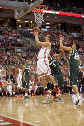 Senior guard Aaron Craft (4) attempts a shot during a game against Michigan State March 9 at the Schottenstein Center. OSU won, 69-67. Credit: Kelly Roderick / For The Lantern