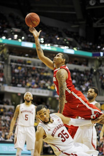Junior forward LaQuinton Ross attempts a shot over a Nebraska defender during the Big Ten Tournament March 14 at Bankers Life Fieldhouse. OSU won, 71-67. Credit: Shelby Lum / Photo editor