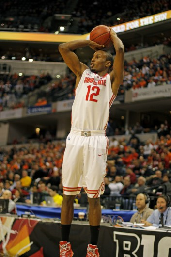 Junior forward Sam Thompson takes a shot during a game against Purdue March 13 at Bankers Life Fieldhouse. OSU won, 63-61. Credit: Shelby Lum / Photo editor