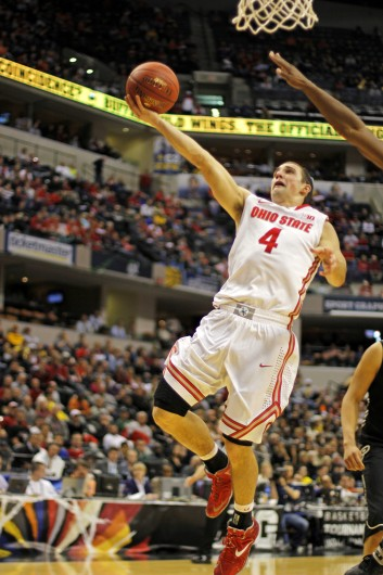 Senior guard Aaron Craft floats for a layup during a game against Purdue March 13 at Bankers Life Fieldhouse. OSU won, 63-61. Credit: Shelby Lum / Photo editor