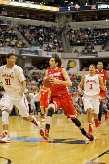 Sophomore guard Amedeo Della Valle drives to the basket during a game against Nebraska March 14 at Bankers Life Fieldhouse. OSU won, 71-67. Credit: Shelby Lum / Photo editor