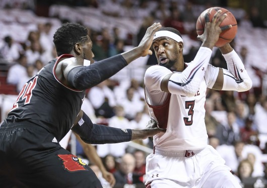 Then-Temple-forward Anthony Lee (3) shields the ball from a defender during a game against Louisville at the Liacouras Center Feb. 14. Temple lost, 82-58. Courtesy of MCT