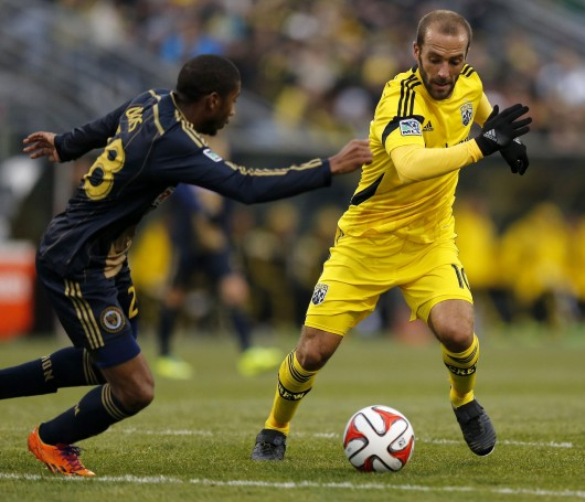 Columbus Crew midfielder Federico Higuain (10) avoids a defender during a game against the Philadelphia Union March 22 at Crew Stadium. The Crew won, 2-1. Courtesy of MCT