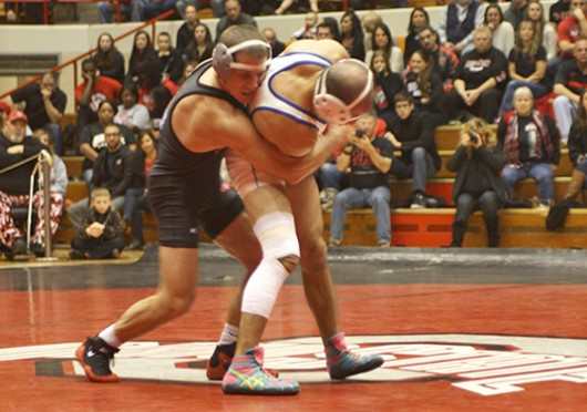 Ohio State redshirt-junior Logan Stieber takes down Notre Dame College sophomore Maurice Miller in the 141-pound match Nov. 15 at St. John Arena. OSU won, 29-11. Credit: Ethan Day / Lantern photographer