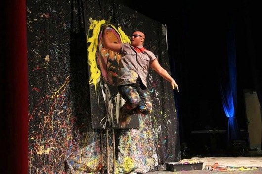 Performance painter David Garibaldi paints at the Ohio Union in an OUAB-sponsored event March 3. Credit: Ritika Shah / Asst. photo editor