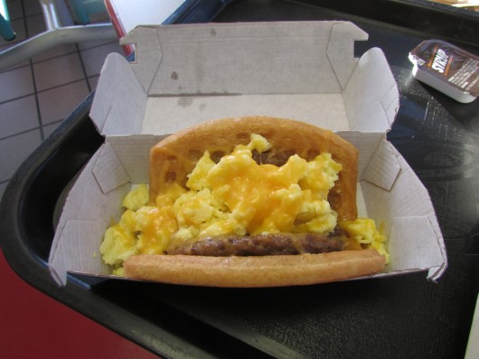 The waffle taco with sausage, one item on Taco Bell's breakfast menu which debuted March 27. Credit: Jacob Hollar / Lantern reporter