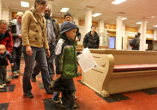 Eli Henderson, 5, walks in front of his mother Beth Henderson to hand the petition against raised parking prices to Interim President Joseph Alutto's office in Bricker Hall March 26. Credit: Shelby Lum / Photo editor