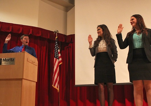 Undergraduate Student Government President-elect and Vice President-elect Celia Wright, left, and Leah Lacure, respectively, take their oath of office on March 26. Credit: Logan Hickman / Lantern photographer