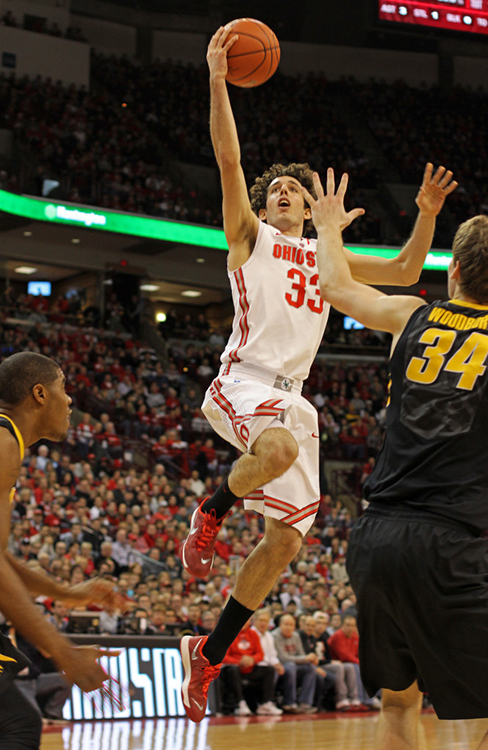 Sophomore guard Amedeo Della Valle (33) attempts a lay up during a game against Iowa Jan. 12 at the Schottenstein Center. OSU lost, 84-74.