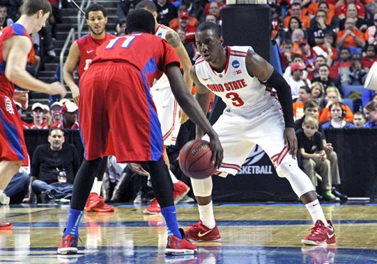 Junior guard Shannon Scott (3) sets himself on defense during a game against Dayton March 20 at First Niagara Center. OSU lost, 60-59. Credit: Ritika Shah / Asst. photo editor