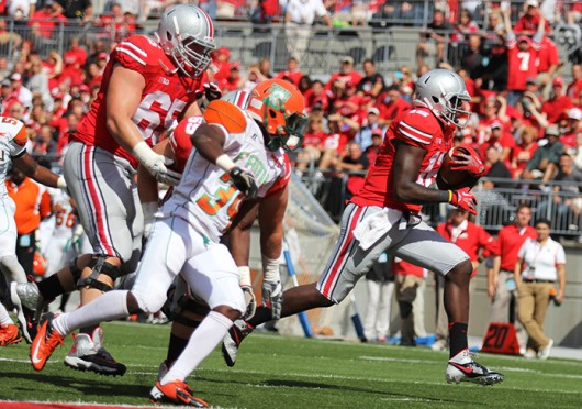 Then-redshirt-freshman Cardale Jones (12) rushes the ball during a game against Florida A&M Sept. 21 at Ohio Stadiun. OSU won, 76-0. Credit: Shelby Lum / Photo editor