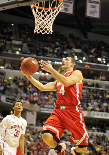 Senior guard Aaron Craft (4) looks towards the basket for a layup during a game against Nebraska in the Big Ten Tournament March 14. OSU won, 71-67. Credit: Shelby Lum / Photo editor