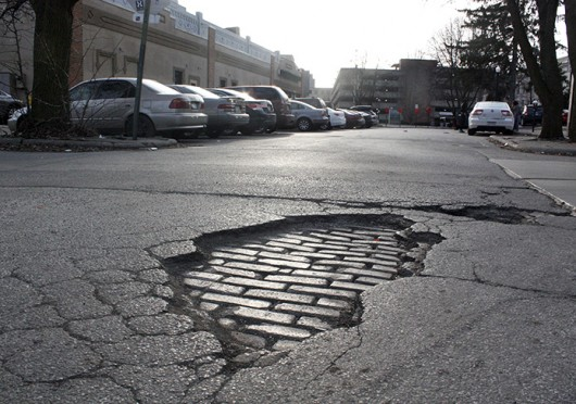 A pothole on OSU's campus. This month, the Columbus Department of Public Service set its street maintenance crews to work in an effort to address the pothole problem that sprung up during this winter's record-setting snowfall. <br />Credit: Alice Bacani / News director of Buckeye TV