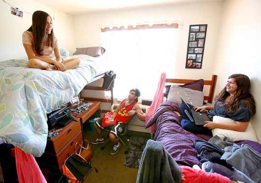 Students hang out in a dorm room at California State University-Northridge. Credit: Courtesy of MCT