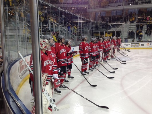 Members of the Ohio State men's hockey team look on during player introductions before a game against Michigan. Feb. 28 in Ann Arbor, Mich. The game ended in a 2-2 tie, but OSU won the shootout, 1-0. Credit: Hayden Grove / BuckeyeTV asst. sports director