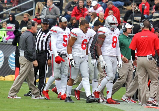 Then-junior quarterback Braxton Miller (5) walks off the field during a game against Purdue Nov. 2 at Ross-Ade Stadium. OSU won, 56-0. Credit: Shelby Lum / Photo editor