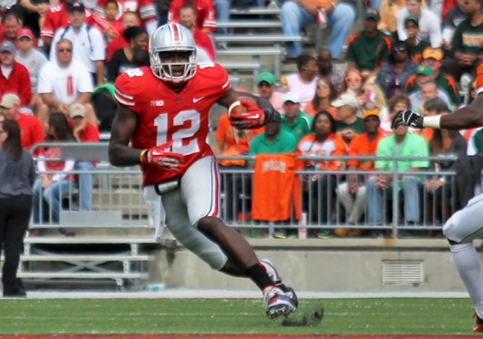 Then-redshirt-freshman quarterback Cardale Jones (12) avoids a defender during a game against Florida A&M Sept. 21 at Ohio Stadium. OSU won, 76-0. Credit: Shelby Lum / Photo editor