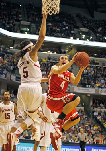 Senior guard Aaron Craft attempts a layup during a game against Nebraska March 14 at Bankers Life Fieldhouse. OSU lost, 71-67. Credit: Shelby Lum / Photo editor