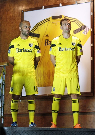 Columbus Crew midfielder Federico Higuain (10) and defender Michael Parkhurst (4) model the teams new uniforms March 4 at Bar Louie in Columbus. Credit: Andrew Todd-Smith / Lantern photographer