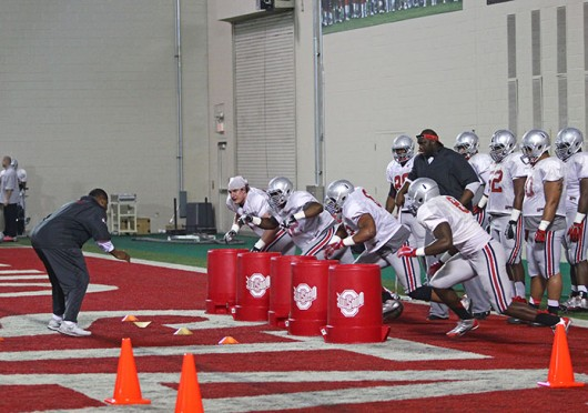Members of the OSU defense line take part in a drill during spring practice March 20 at the Woody Hayes Athletic Center. Credit: Mark Batke / For The Lantern