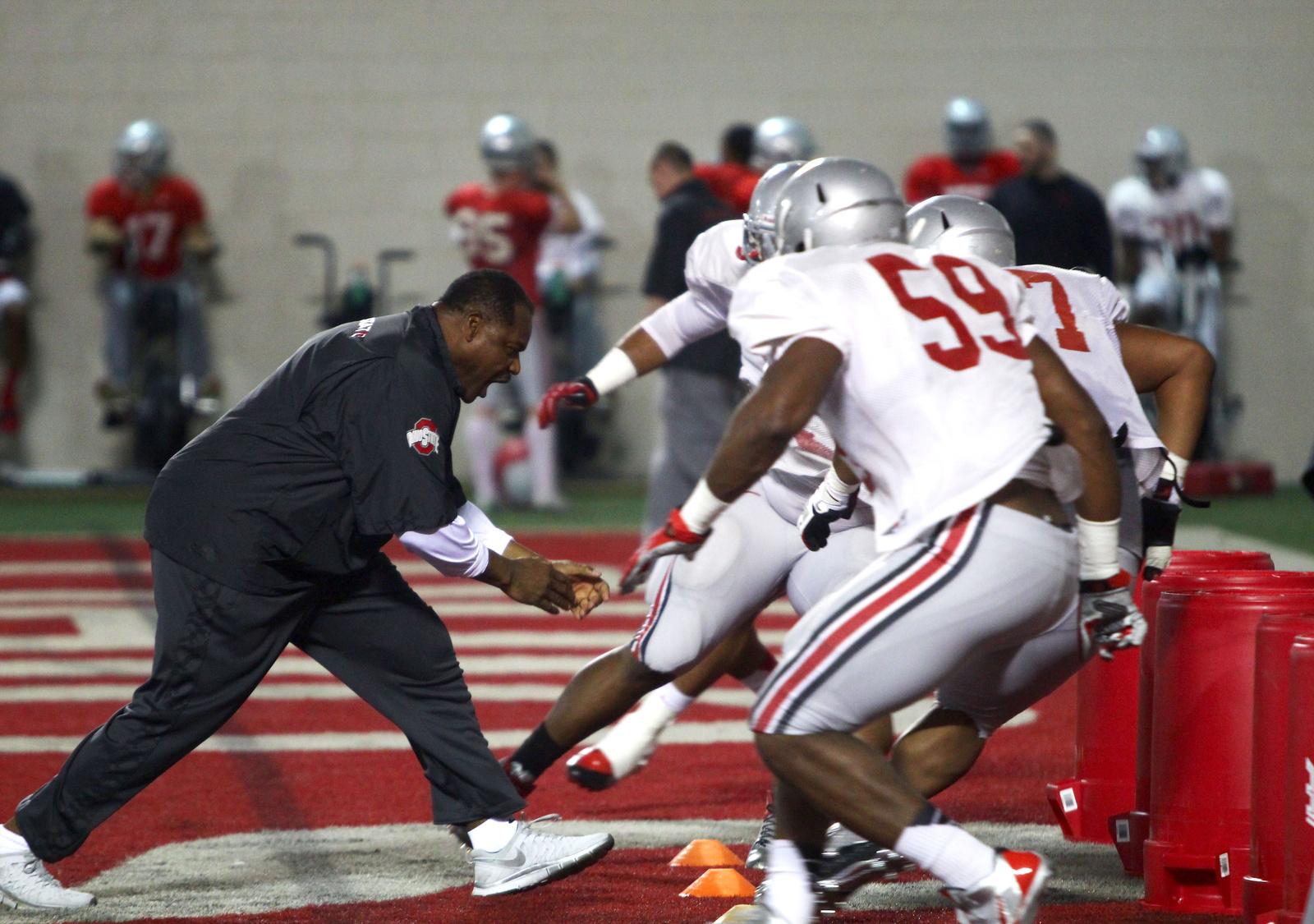 OSU defensive line coach Larry Johnson runs drills with players during spring practice March 20 at the Woody Hayes Athletic Center.