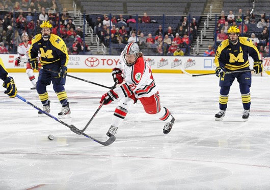 Sophomore forward Tyler Lundey (23) attempts a shot during a game against Michigan March 2 at Nationwide Arena. OSU lost, 4-3. Credit: Ben Jackson / For The Lantern
