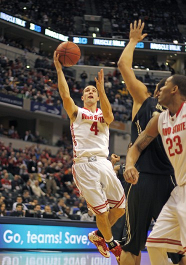 Senior guard Aaron Craft (4) attempts a layup during a game against Purdue March 13 at Bankers Life Fieldhouse. OSU won, 63-61. Credit: Shelby Lum / Photo editor
