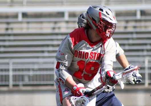 Junior midfielder Jesse King (19) looks for an open teammate during a game against Penn State March 1 at Ohio Stadium. OSU lost, 11-7. Credit: Ryan Robey / For The Lantern