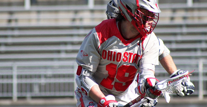 Then-junior midfielder Jesse King (19) looks for an open teammate during a game against Penn State March 1 at Ohio Stadium. OSU lost, 11-7. Credit: Lantern file photo