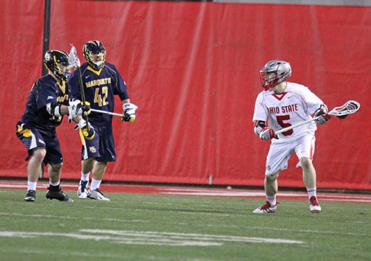 Junior midfielder Turner Evans (5) cradles the ball during a game against Marquette Feb. 22 at the Woody Hayes Athletic Center. OSU won, 11-7. Credit: Brett Amadon / Lantern reporter