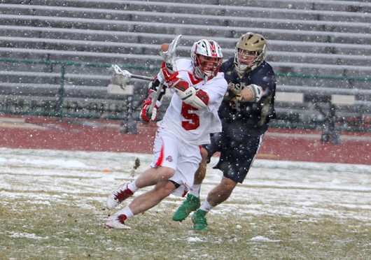 Junior midfielder Turner Evans (5) works around a defender during a game against Notre Dame March 25 at Jesse Owens Memorial Stadium. OSU lost, 13-7. Credit: Shelby Lum / Photo editor